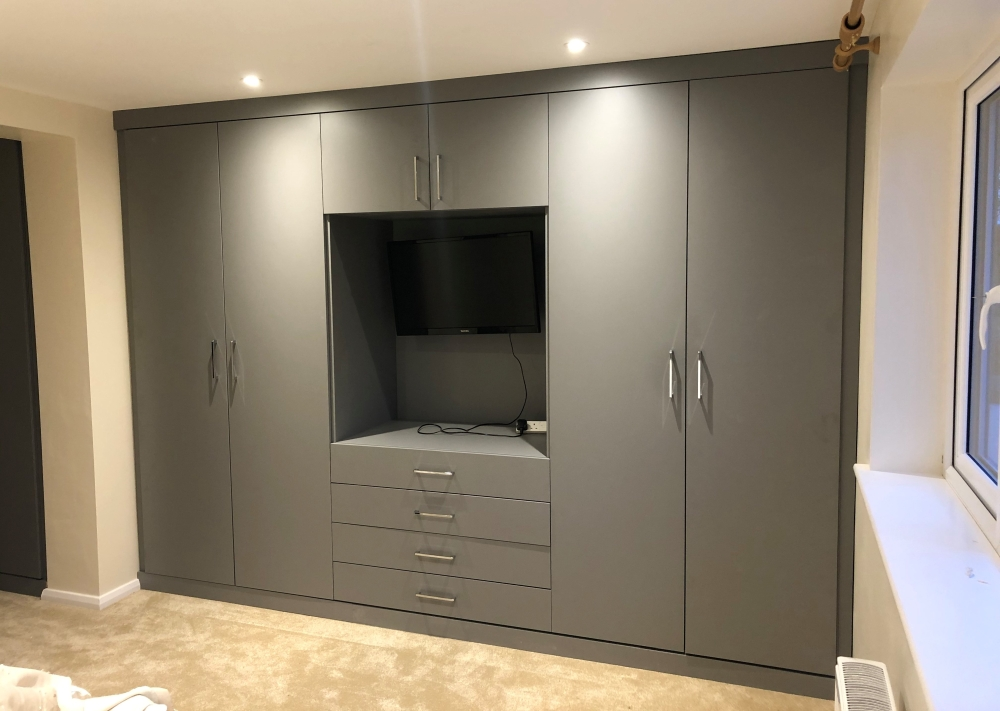 fitted wardrobe with tv area